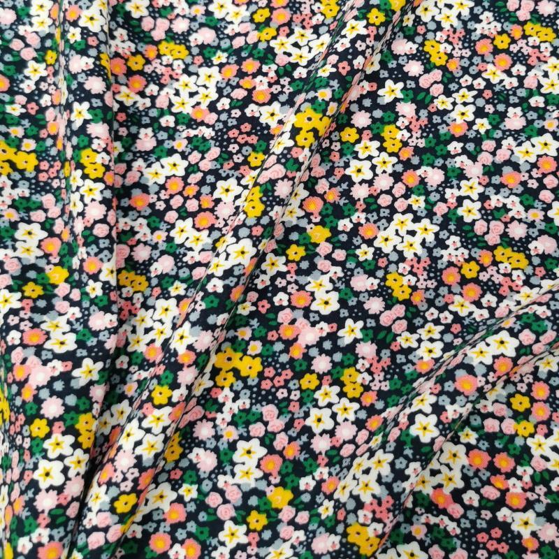 Petites fleurs jaune vert rose fond bleu marine 2